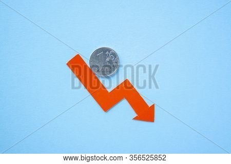 One Rouble Coin On Blue Background With Red Arrow Down. Exchange Rate Chart. Ruble Depreciation. Exc