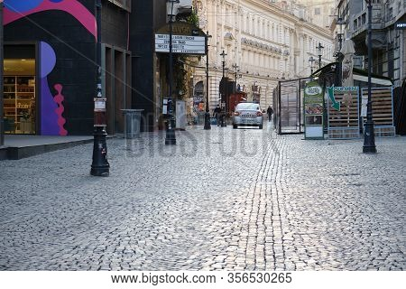 Bucharest, Romania - March 19, 2020: Police Car Patrolling In An Empty Old City Center After Bars An