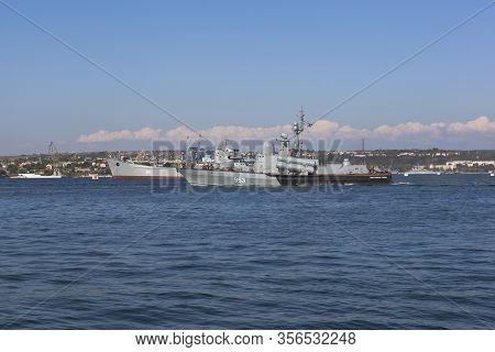 Sevastopol, Crimea, Russia - July 26, 2019: R-239 Missile Boat Naberezhnye Chelny Goes Along The Sev