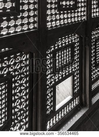 Black And White Angle View Of Interleaved Wooden Ornate Windows - Mashrabiya - In Abandoned Building