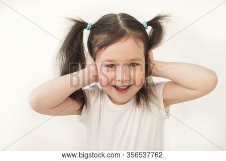 The Baby Covered Her Ears. The Child Does Not Want To Hear Anything. Young Baby Indulges