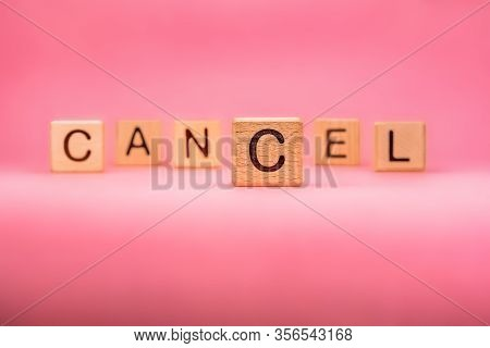 Cancel Word Made With Building Blocks, Business Concept. Word Cancel On Pink Background. Event Cance