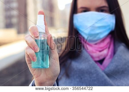 Woman Sprays Hand Disinfector From Virus, Chosen Focus