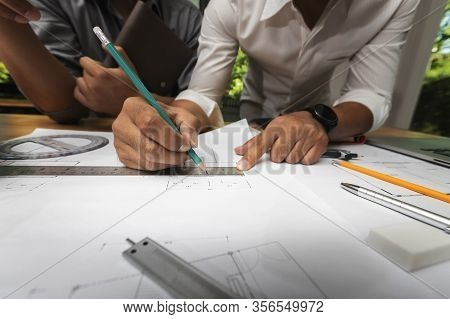 Confident Team Of Architect Working Together In A Office.they Discussing About New Startup Project O