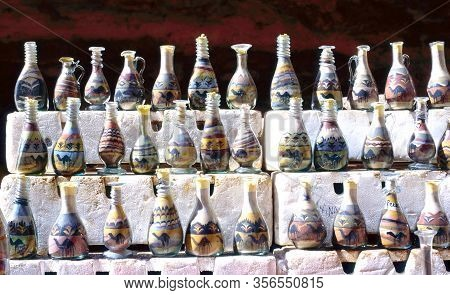 Stack Of Sand Bottles With Different Kinds Of Coloured Sand Taken From Petra Gorge For Sale In A Sou