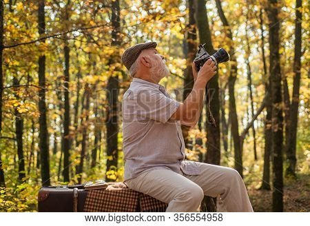 Shooting Autumn Session. Old Man Shoot In Nature. Landscape And Nature Photo Shooting. Using Handhel