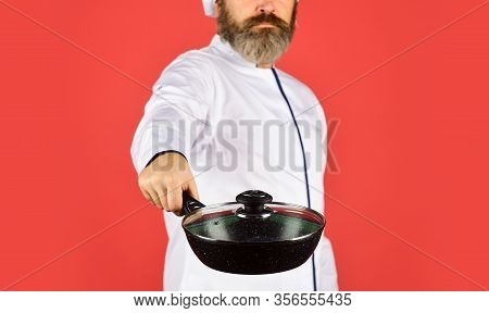 Catering. Chef Man Holds Kitchenware. Selective Focus. Happy Cook Man Hold Frying Pan. Chef Uniform