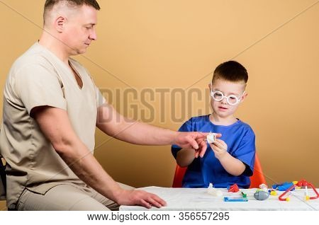 First Aid. Medical Help. Trauma And Injurie. Medicine Concept. Kid Little Doctor Sit Table Medical T