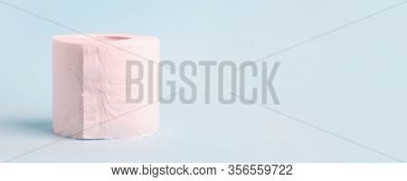 Toilet Roll On Blue Background. Concept Of Lack Of Toilet Paper In Stores Due To Coronavirus, Covid-