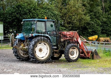 Tyndrum, Scotland - August 1, 2020: New Holland T5060 Tractor With Chilton Loader At The Farm And Ca