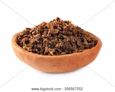 Granules Of Bee Propolis In A Clay Bowl On A White Background. Propolis Is A Natural Antibiotic Agai