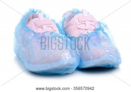 Shoes In Shoe Covers On White Background Isolation