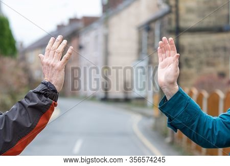 Social Distancing Wave. Recommended Greeting To Avoid The Spread Of Coronavirus. Two Friends Meet, I