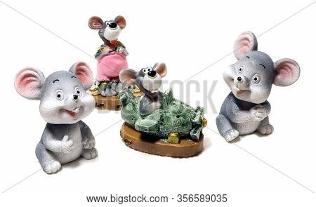 A Figurine Of Mouse Isolated. A Ceramic Figurine Mice Isolated.
