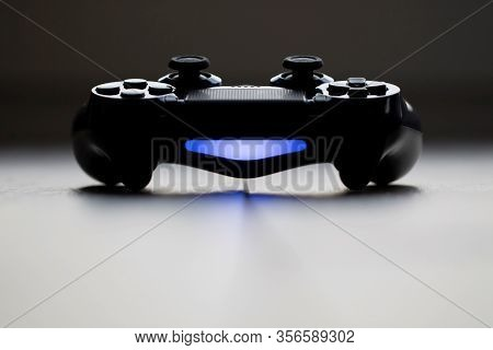 Brecht, Belgium - Februari 1 2020: A Frontal Dark Close Up Portrait Of A Turned On Playstation 4 Con