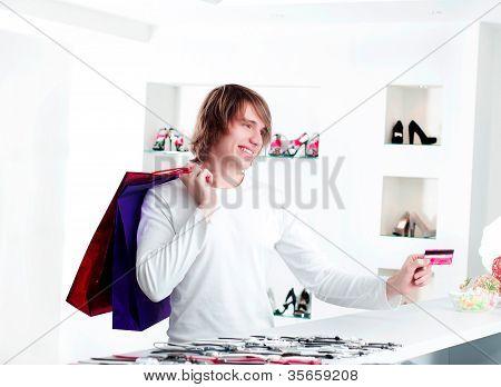 Man At Shopping Checkout Paying Credit Card