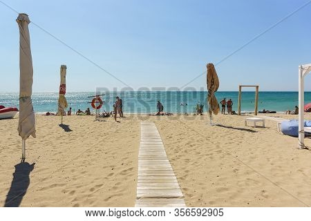 Yevpatoria, Crimea, Russia-12 September 2019: Paved Wooden Path To The Sea. The Popular Beach Of