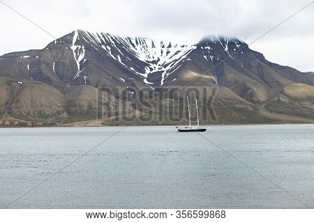 The Photo Shows A Sailing Ship In A Bush On Svalbard