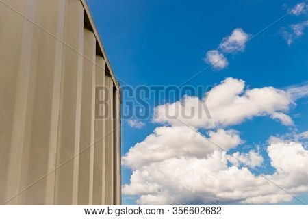 Shipping Container Close Up And Blue Sky And White Clouds