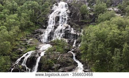 Waterfall Springing In National Park, Norway. Waterfall In Norway Forest At Rainy Summer. Norway Nat