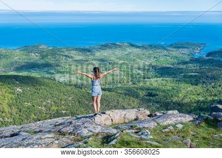Woman Enjoying The Beautiful View Of Small Islands Seen From Cadillac Mountain In Acadia National Pa