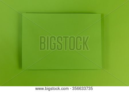 Mosk Up. Abstract Green Paper Background. In The Center Of The Frame On A Green Surface Is A Green P