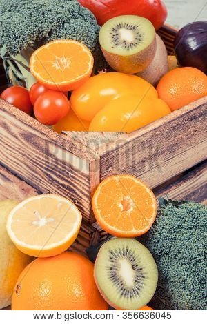 Heap Of Fresh Ripe Fruits With Vegetables In Rustic Wooden Box. Nutritious Food Containing Healthy M
