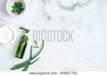 Aloe Vera Spa Treatment Concept. Top View Green Bottle With Aloe Vera Gel, Hand Cream And Sliced Ste