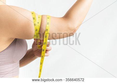 Woman Show And Squeeze Tighten, Arm Body Fat By Measure Tape, Woman Diet Lifestyle Concept