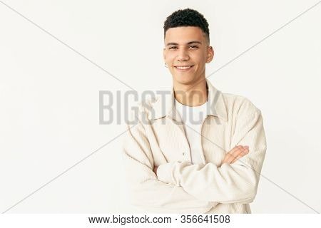 Cheerful Man Standing With Crossed Arms. Portrait Of Handsome Confident Young Man Standing With Cros