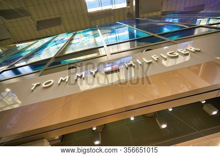SINGAPORE - APRIL 21, 2019: Tommy Hilfiger sign seen in Singapore Changi Airport. Tommy Hilfiger is an American premium clothing company.