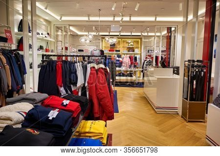 SINGAPORE - APRIL 21, 2019: clothes on display at Tommy Hilfiger store in Singapore Changi Airport. Tommy Hilfiger is an American premium clothing company.
