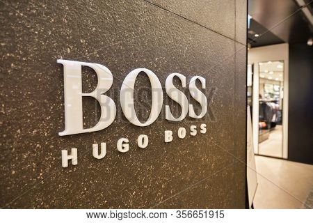 SINGAPORE - APRIL 21, 2019: close up shot of Hugo Boss sign seen in Singapore Changi Airport. Hugo Boss AG is a German luxury fashion house headquartered in Metzingen.