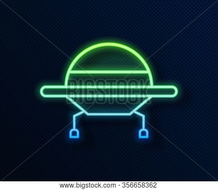 Glowing Neon Line Ufo Flying Spaceship Icon Isolated On Blue Background. Flying Saucer. Alien Space