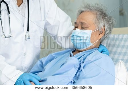 Doctor Help And Care Asian Senior Or Elderly Old Lady Woman Patient Wearing A Face Mask In Hospital