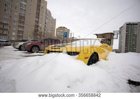 Yellow Chevrolet Camaro Car Under Snow Omsk, Russia, 29.02.2020