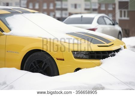 Sporty Car Chevrolet Camaro Waiting For Spring Like Snowdrop Omsk, Russia, 29.02.2020