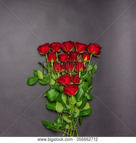 Bouquet Of Fresh Red Rose Flowers On Black Background. Floral Composition, Mourning Card For Event,