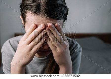 Close Up Images Of Thoughtful Insecure Young Woman Touching Forehead Having Headache Migraine Or Dep