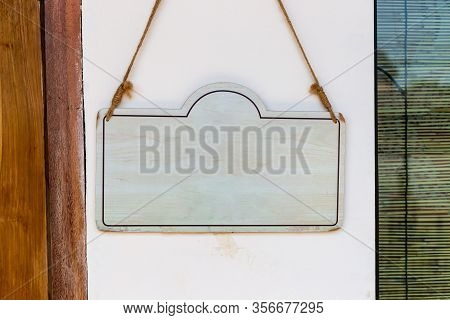 Wooden Doors With Glass Hanging, Japanese Wooden Signs In Front Of The Cafe. Copy Space Background