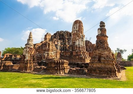 Landscape Of  Wat Mahathat In Buddhist Temple Is A Temple Built In Ancient Times At Ayutthaya Near B