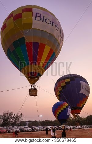 Nakhon Ratchasima, Thailand - February. 3, 2020: Colorful Hot Air Balloons Flying Above The Ground A