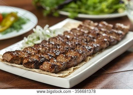 Fast Food. Eastern Food. Shish Kebab, Lyulya-kebab. Dishes Of Oriental Cuisine Lying In Plte And Dec