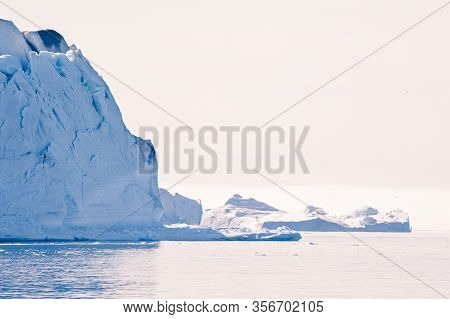 Big Icebergs In The Ilulissat Icefjord At Sunset, Western Greenland