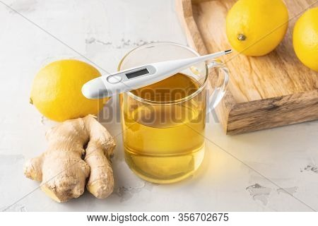 Alternative Medicine, Natural Home Remedy For Cold And Flu. Hot Herbal Tea With Ginger And Lemon Ove