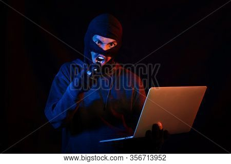 Terrorist Man Cyber Hacker Hacking Internet To Access Steal Information By Laptop Computer