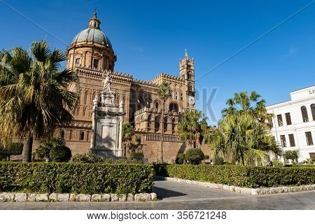 The Bell Tower With Clock And Cupola Of Palermo Cathedral With Palm Trees In Sicily, Italy