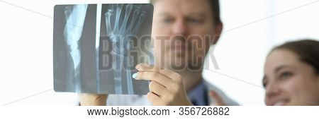 Focus On Refined Female Hand Of Cute Woman Holding Snapshot. Professional Hakeem And Nurse Making Di
