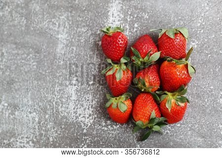 Red Ripe Strawberries Lies On A Concrete Background