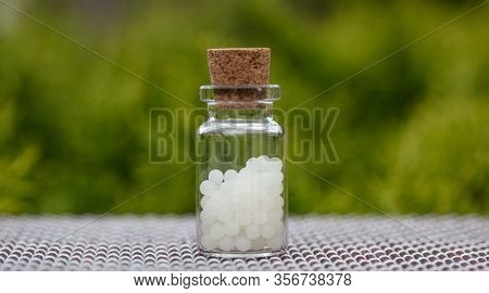 Homeopathy, Globules In A Glass Bottle, Nature Background